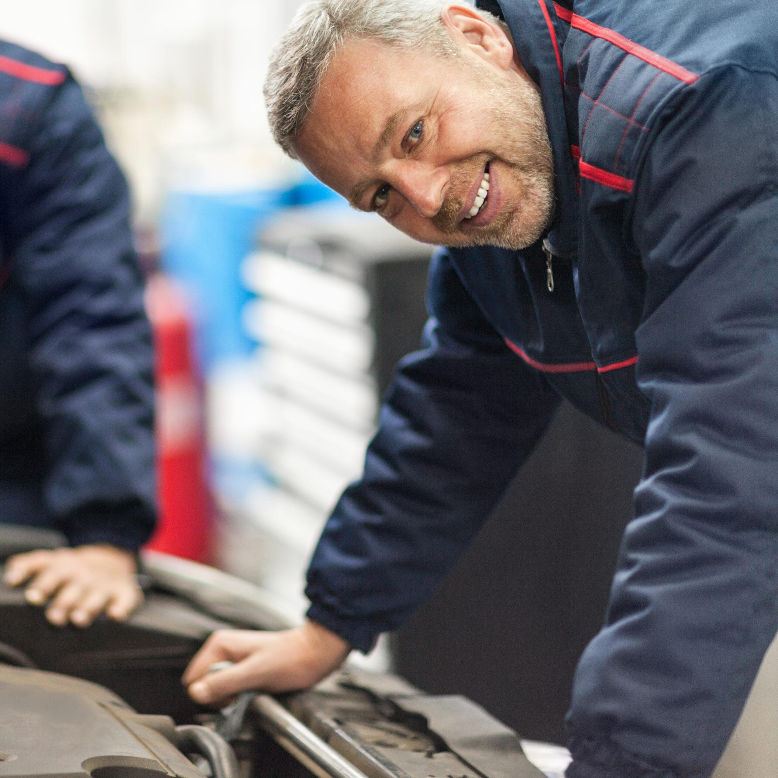 Auto mechanics working in repair shop